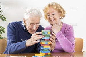 stock-photo-31529698-nursing-home-senior-couple-playing-with-wooden-blocks